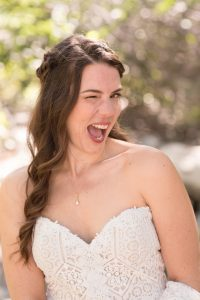 Bride winks at the camera during her southern California elopement Thurman Flats