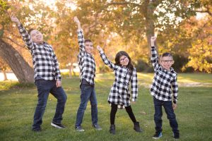 Four kids in buffalo check shirts hit a pose from Hamilton the musical in Yucaipa California